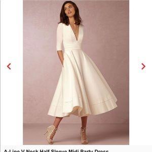 Dresses & Skirts - NOVASHE Dress (new)